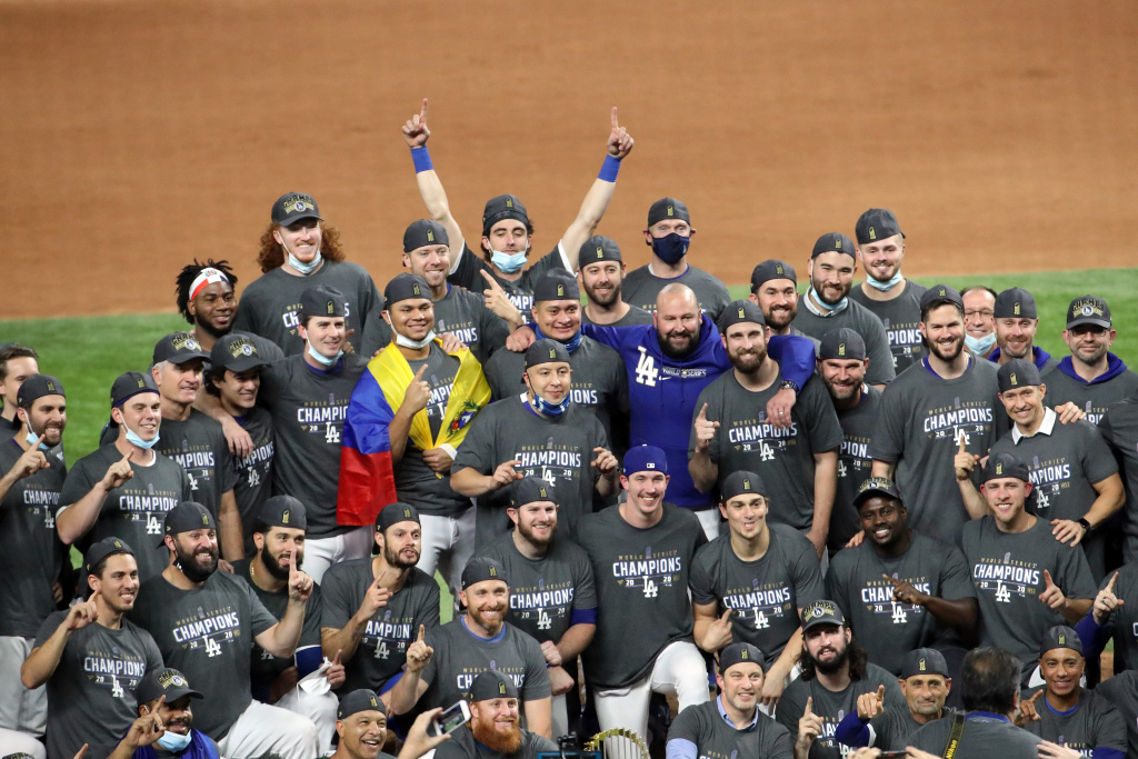 The Los Angeles Dodgers pose for a photo after defeating the Tampa Bay Rays 3-1 in Game Six to win the 2020 MLB World Series at Globe Life Field on October 27, 2020 in Arlington, Texas.