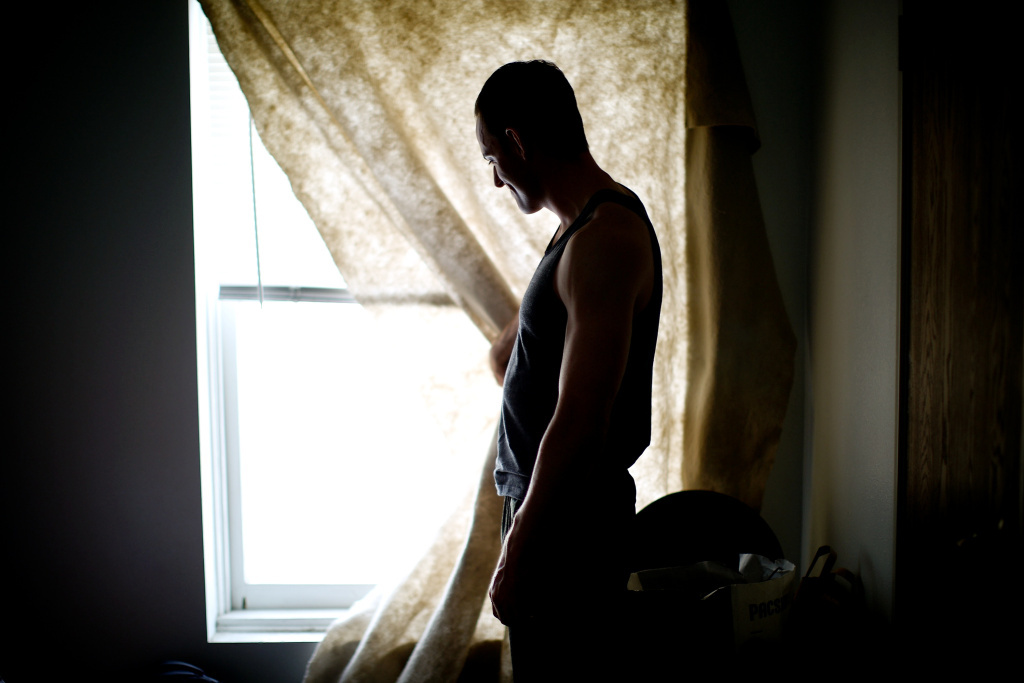 File: Daniel Harmon, a veteran of the wars in both Afghanistan and Iraq, looks out the window of his room at the Hollywood Veterans Center in Los Angeles. The facility provides housing to homeless vets.