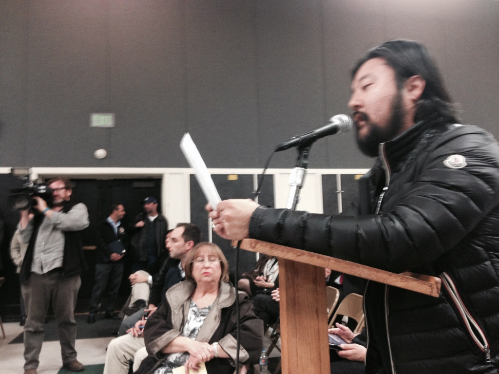 Eric Nam addresses members of the state Assembly Utilities and Commerce Committee at Granada Hills Charter High School Jan. 21, 2016. He lives near a natural gas leak that has led thousands of families to relocate away from Porter Ranch, Granada Hills and Chatsworth.