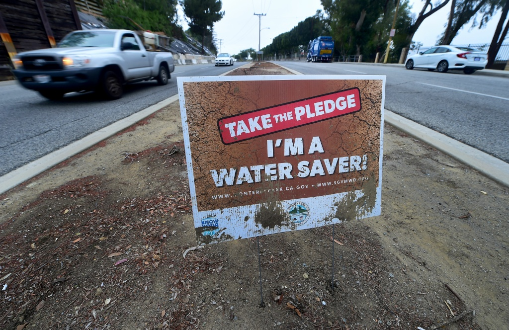 A water conservation sign remains in what was once a grass-covered traffic divider in Monterey Park, California on May 19, 2016.