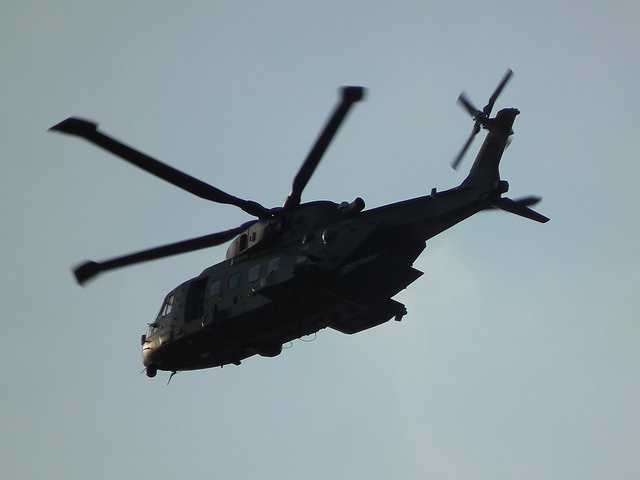 A military helicopter takes flight on September 16, 2011. United Technologies Corp. has pleaded guilty to illegally distributing software oversees used to develop military helicopters.