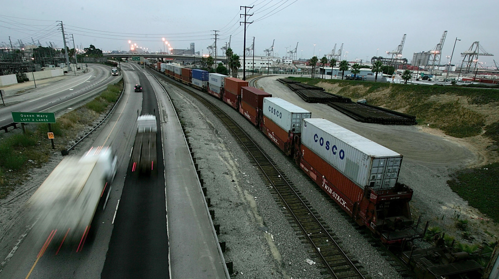 File: Trucks move along the I-710 Freeway.