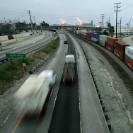 Trucks move along the I-710 freeway