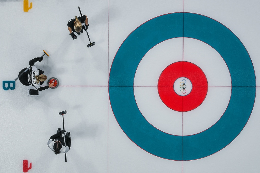 Athletes from Russia and Britain compete during the curling women's round robin session during the Pyeongchang 2018 Winter Olympic Games at the Gangneung Curling Centre on February 14, 2018.
