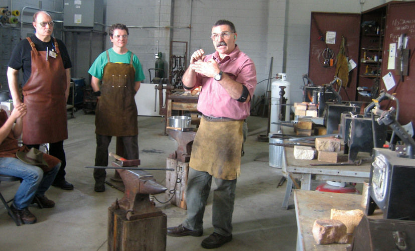 Mark Aspery, right, teaches a blacksmith class at Adam's Forge in Los Angeles.