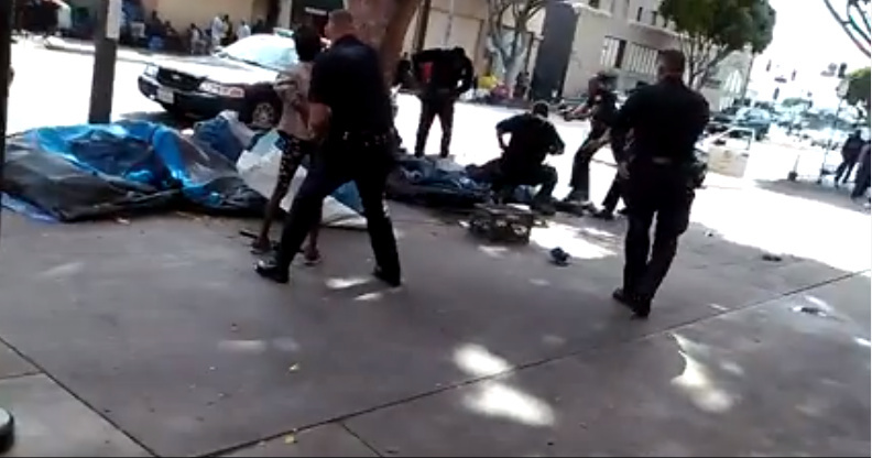 A screenshot of a video posted on Facebook shows at least five officers responding to a situation in Skid Row and shooting a man.