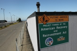 An American Recovery and Reinvestment Act sign is posted at the construction site of a half-completed 236-foot FAA control tower at Oakland International Airport on August 3, 2011