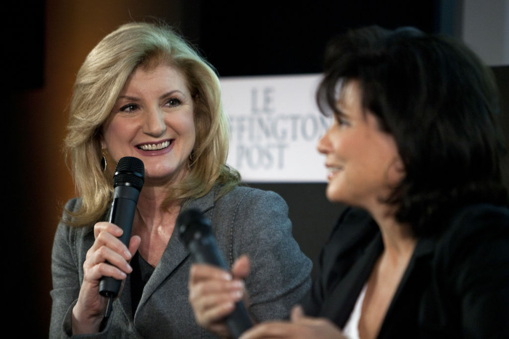 Editorial director of the French version of the Huffington Post's news website Anne Sinclair, right, and co-founder of