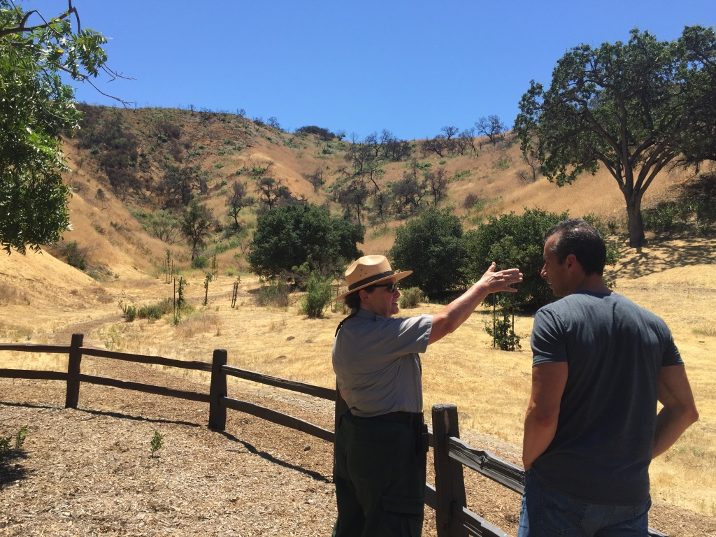 Marti Witter points out plant life to A Martinez at Wild Walnut Park in Calabasas.