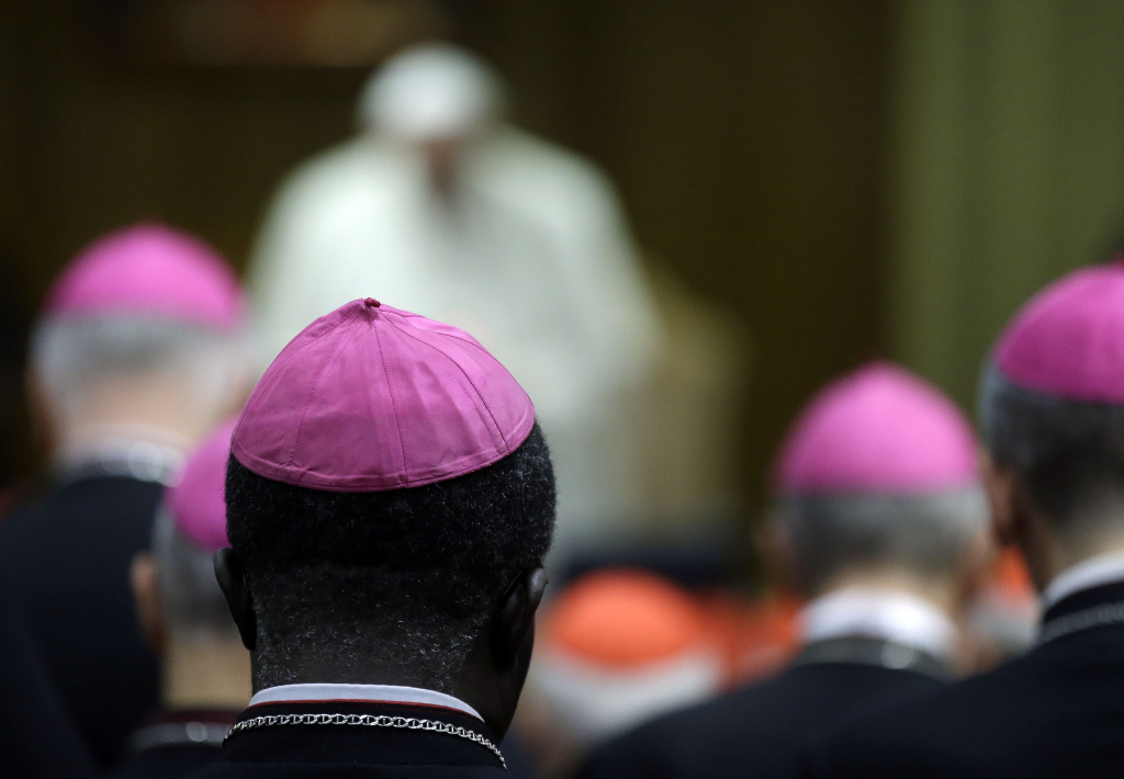 Prelates and Pope Francis attend a morning session of a two-week synod on family issues at the Vatican, Monday, Oct. 13, 2014. (AP Photo/Gregorio Borgia)