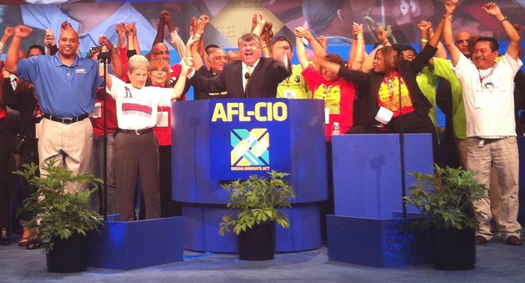 Members of the AFL-CIO – including President Rich Trumka in the suit behind the podium – during the union's convention in downtown Los Angeles on Sept. 9, 2013.