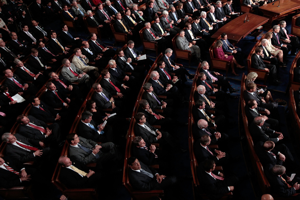 Republican members of Congress listen as U.S. President Barack Obama addresses a Joint Session of Congress at the U.S. Capitol September 8, 2011 in Washington, DC.