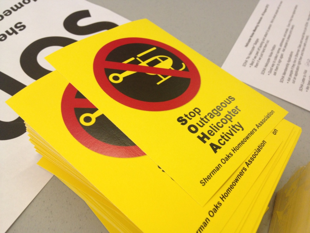 Members of the Sherman Oaks Homeowners Association had yellow stickers printed to show their opposition to helicopters flying over neighborhoods.