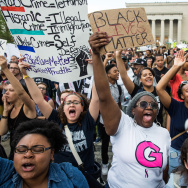 Protesters rally in front of to City Hall in support of the decision to bring charges against the six police officers who arrested Freddie Gray on May 2, 2015 in Baltimore, Maryland.