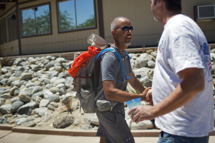 Randy Brown, left, is greeted by Mary Kay House, before Brown's stop for lunch at Vista Del Mar Clubhouse during his six-day walk around the Salton Sea on Friday, June 12, 2015. Brown is attempting to be the first person to ever walk around the shoreline of the Salton Sea, California's largest lake.