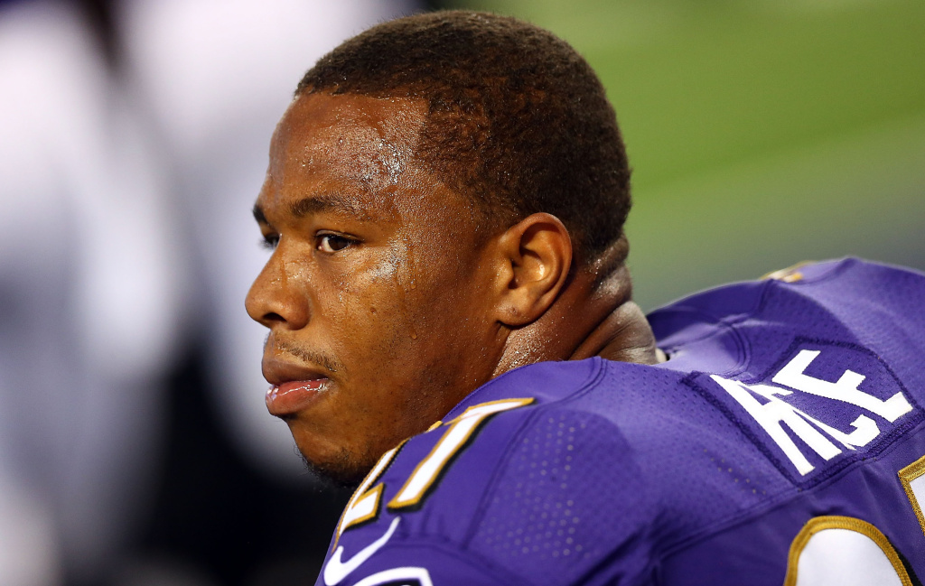 Ray Rice #27 of the Baltimore Ravens sits on the bench against the Dallas Cowboys in the first half of their preseason game at AT&T Stadium on August 16, 2014 in Arlington, Texas. Rice was suspended two games after video surfaced of him knocking his then-fiancee unconscious in an elevator.