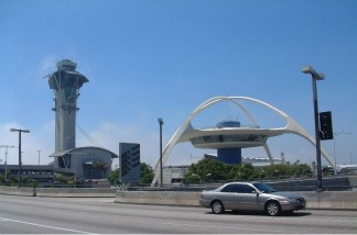 A car drives to the LAX departure terminal.