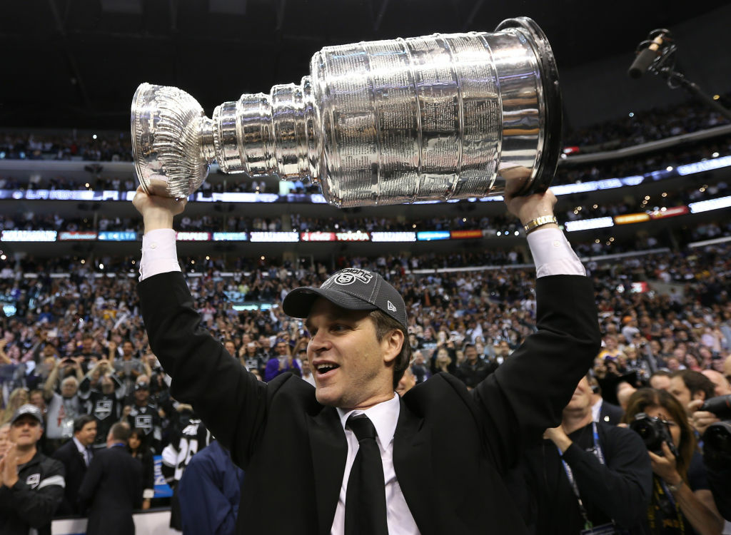 President, Business Operations, Alternate Governor Luc Robitaille of the Los Angeles Kings holds up the Stanley Cup after the Kings defeated the New Jersey Devils 6-1 to win the Stanley Cup series 4-2 in Game Six of the 2012 Stanley Cup Final at Staples Center on June 11, 2012 in L.A., Calif.