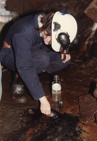 A scientists takes a sample of water from a mine deep underground in Ontario, Canada. The water turned out to be 2.6 billion years old, the oldest known water on Earth.
