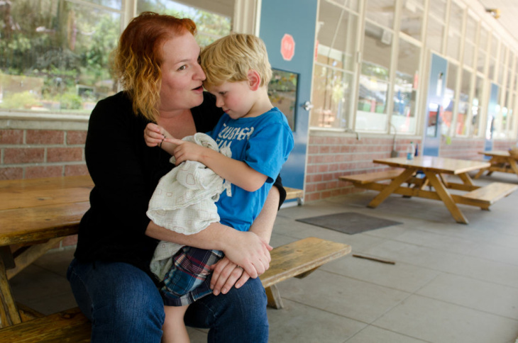 JPL engineer, Liz Johnson, visits with her son, Connor Johnson, as he wakes up from nap time.