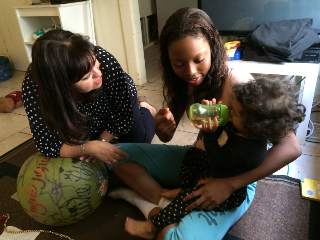In this file photo, therapist, Lorena Samora, visits the home of Shantoya Byrd and Anmarie Paz each week to help the family deal with the severe separation anxiety the baby was experiencing.