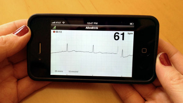 AliveCor CEO Judy Wade demonstrates her company's new, FDA-approved heart monitoring device and application.