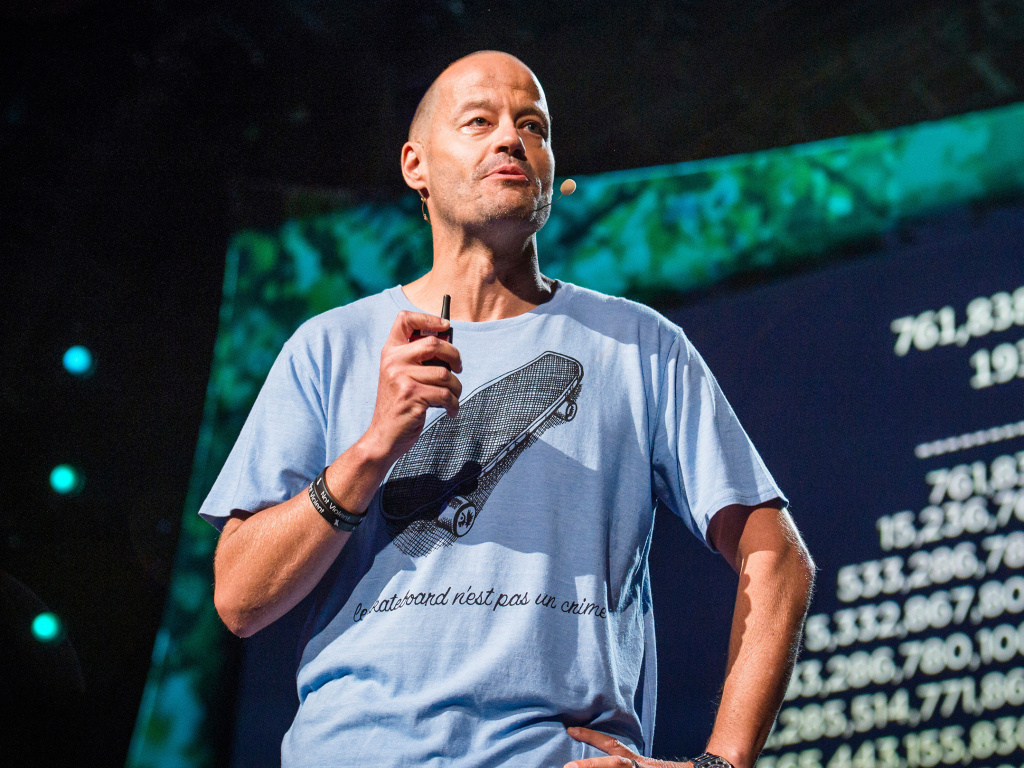Adam Spencer on the TED stage.