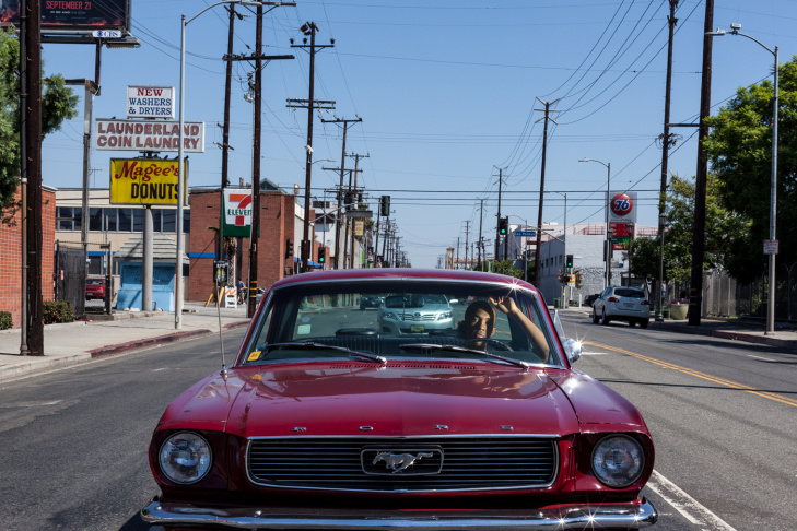 A woman is photographed in her car in East Hollywood by Jonathan Castillo, as part of his 'Car Culture' series.