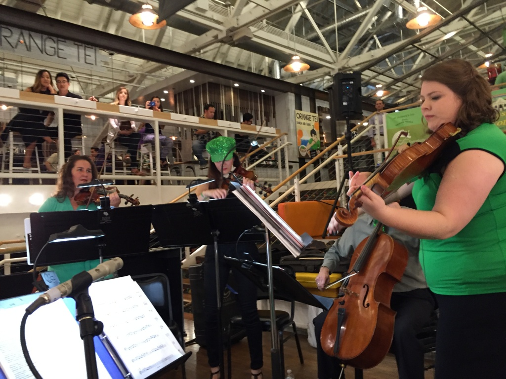 Six members of the Pacific Symphony set up in the middle of the busy Anaheim Packing District for a night of music and trivia.