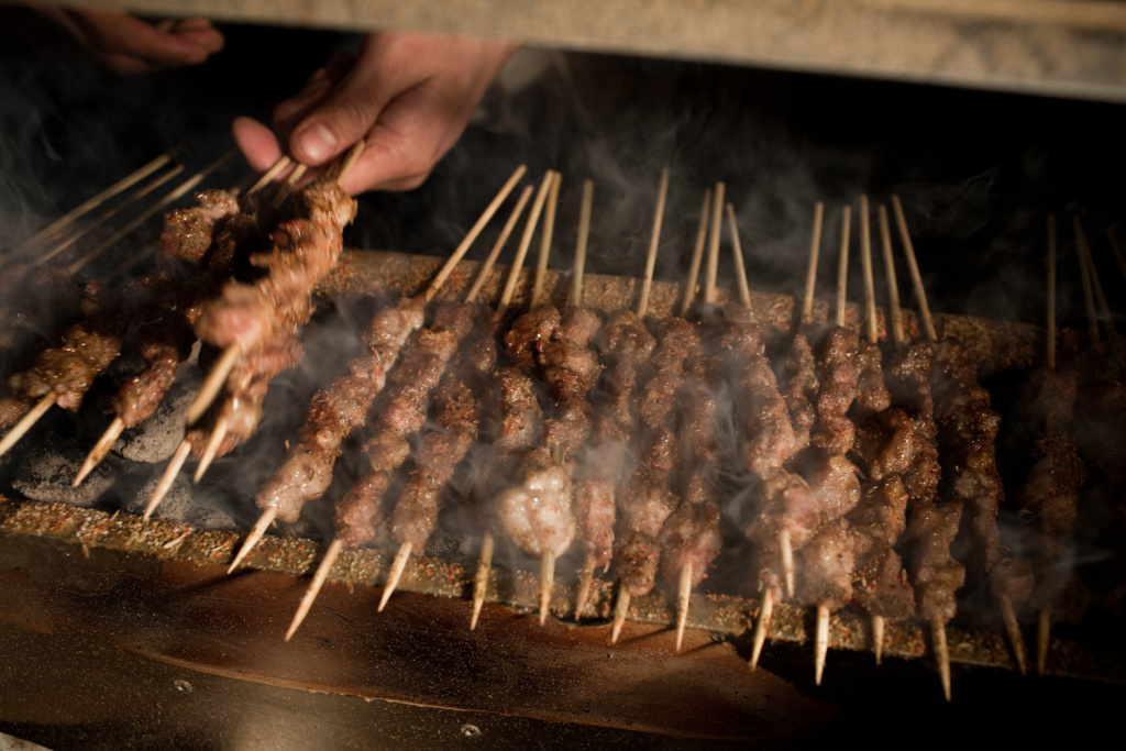 The Kebab Brothers prepare lamb kebabs with cumin and charcoal.