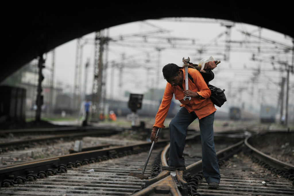 A linesman uses a hammer to adjust a rail at a train station in New Delhi on July 31, 2012. India's worst power grid failure in more than a decade and a deadly train fire on Monday highlighted the crumbling infrastructure holding back Asia's third-largest economy, according to experts. 'Infrastructure has always been the soft spot of the Indian economy — there has not been enough investment, which has lowered the potential growth rate,' Dariusz Kowalczyk, senior economist at Credit Agricole, told AFP.