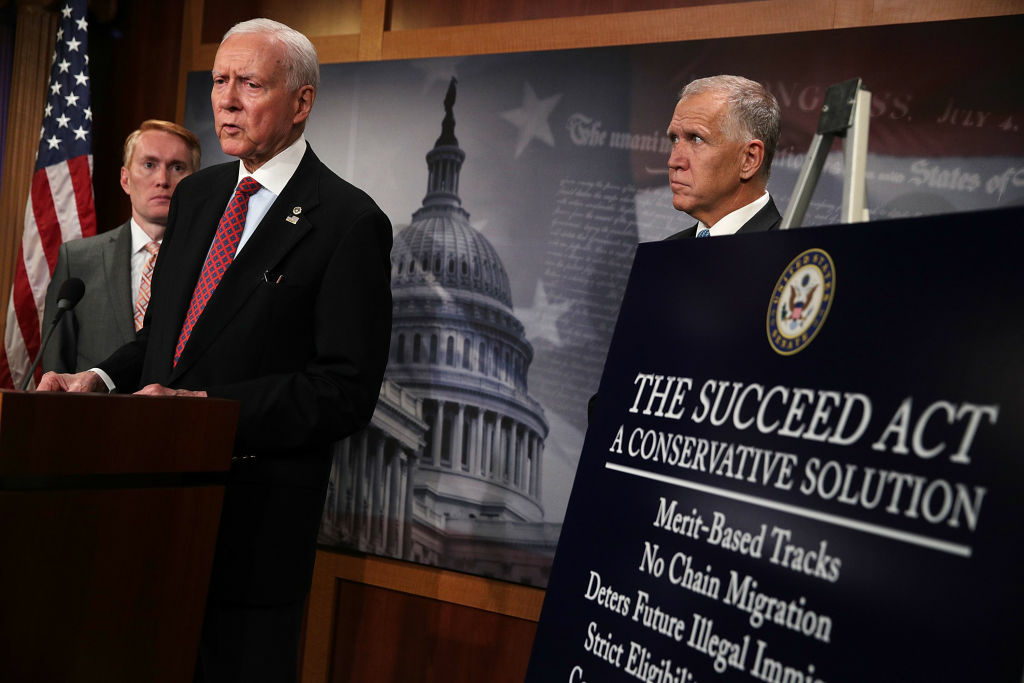 U.S. Sen. Orrin Hatch (R-UT) (2nd L) speaks as Sen. James Lankford (R-OK) (L) and Sen. Thom Tillis (R-ND) (R) listen during a news conference to announce the