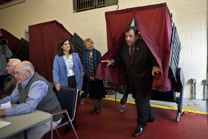 New Jersey Gov. Chris Christie exits a voting booth after casting his ballot for New Jersey governor in the general election as his wife Mary Pat Christie (L) looks on in a polling center on Nov. 5, 2013 in Mendham, New Jersey.
