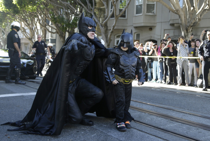 Miles Scott, dressed as Batkid, talks strategy with Batman before saving a woman from peril in San Francisco on Friday. The Make-A-Wish Foundation turned San Francisco into Gotham City for Miles, creating a daylong event to grant the leukemia survivor's w