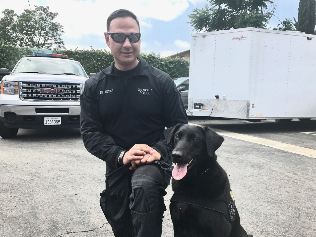 Police dog Nellie and her handler, Tom Deluccia.