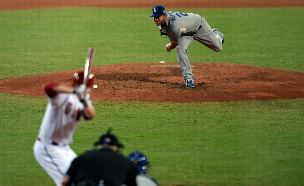 Los Angeles Dodgers' Clayton Kershaw throws a pitch to Arizona Diamondbacks' Mark Trumbo during the Major League Baseball (MLB) season opening game between the Los Angeles Dodgers and the Arizona Diamondbacks at the Sydney Cricket Ground in Sydney on March 22, 2014.