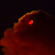 The moon is turned blood-red by smoke from the Lake Fire near Pioneertown late Wednesday night.