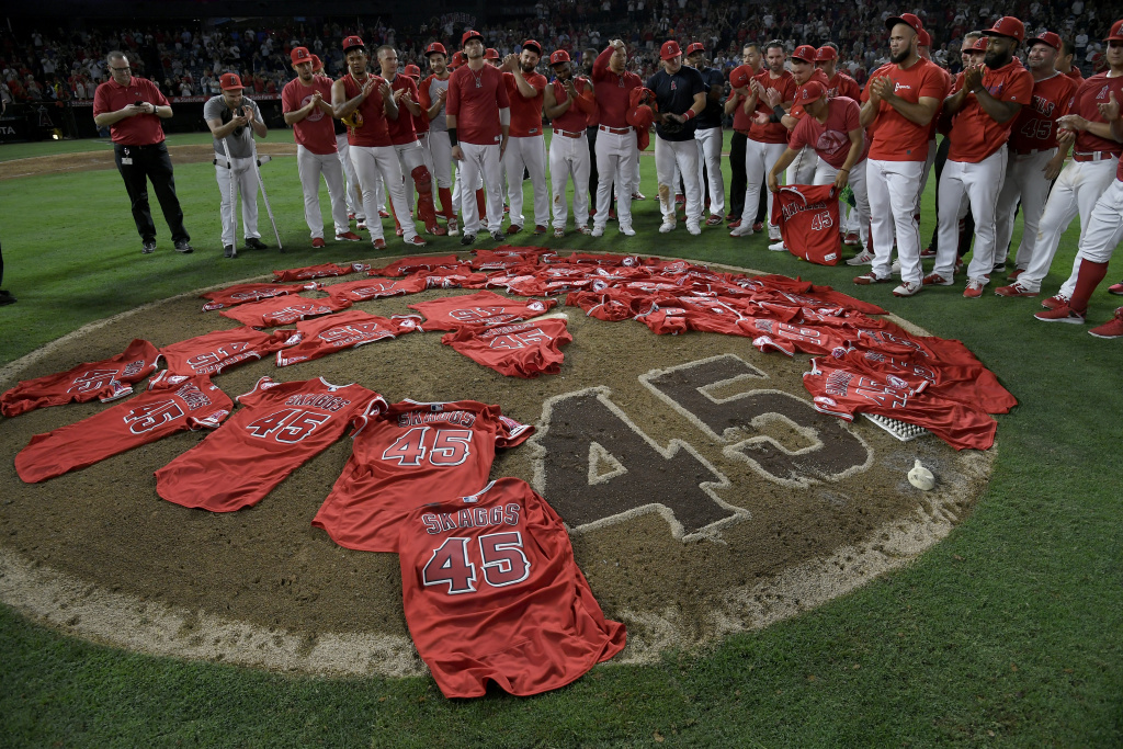 ANAHEIM, CA - JULY 12: Los Angeles Angels of Anaheim players lay their jerseys on the pitchers mound after they won a combined no-hitter agasint the Seattle Mariners at Angel Stadium of Anaheim on July 12, 2019 in Anaheim, California. The entire Angels team wore Tyler Skaggs #45 jersey to honor him after his death on July 1. Angels won 13-0. (Photo by John McCoy/Getty Images)