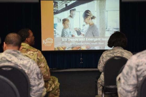 Service members attend a briefing on STIs at McConnell Air Force Base, Kansas.