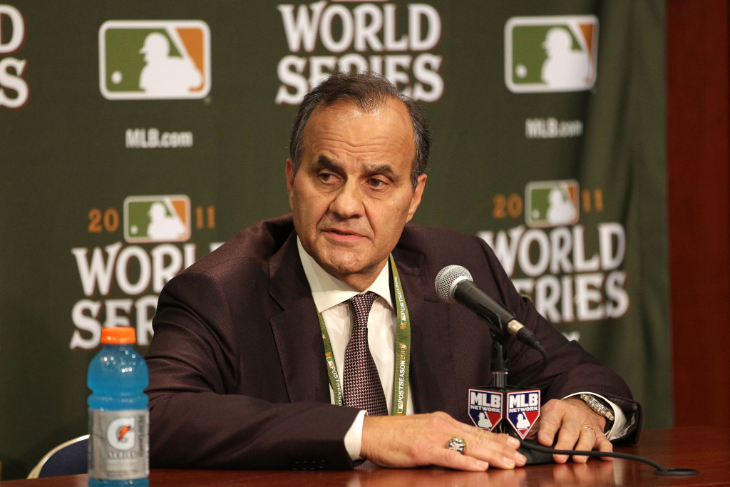 File: Joe Torre addresses the media to discuss a missed call in the 2011 World Series Game Three by first base umpire Ron Kulpa prior to Game Four, Oct. 23, 2011.