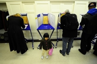 New York residents cast their vote in the US mid-term elections at a polling station at a school in Harlem in New York, November 2, 2010.