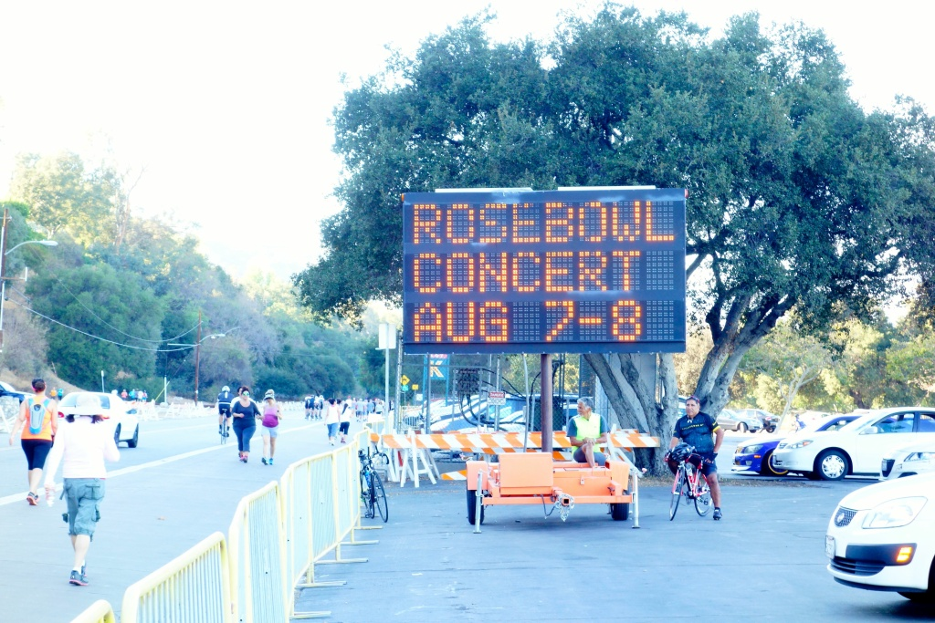 FILE PHOTO: Signs around the Rose Bowl warn of expected traffic delays for concerts. A Metro grant will allow Pasadena to improve street signals for better traffic flow.