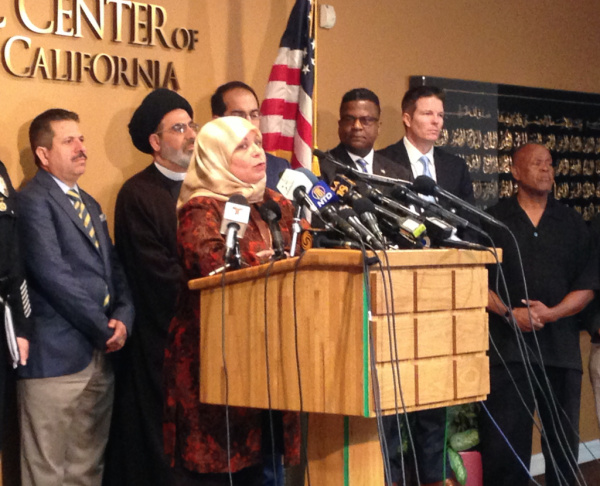 Hedab Tarifi, chair of the Islamic Center of Southern California, speaks at the mosque on Monday along  with other Islamic leaders and representatives from law enforcement agencies. The Islamic center is one of a handful of Southern California mosques that have received threatening letters from an unidentified sender.