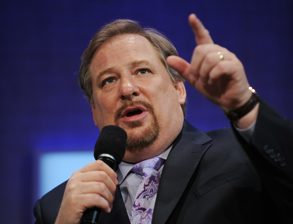 Rick Warren, pastor of Orange County's Saddleback Church, speaks at the Clinton Global Initiative (CGI) in New York. The church announced on Saturday that his 27 year-old son had committed suicide Friday night.