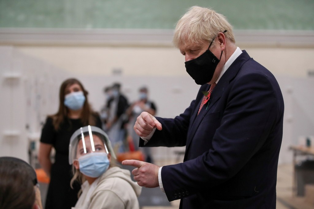 British Prime Minister Boris Johnson speaks to staff at a testing centre in De Montfort University, amid the outbreak of the coronavirus disease (COVID-19) on November 6, 2020 in Leicester, United Kingdom.