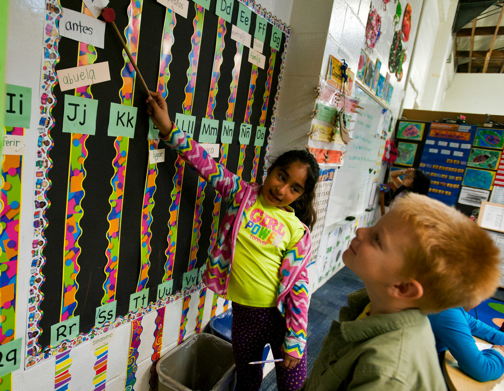 Spanish-primary student Jessica Ortiz helps English-primary student Jack Barnes, both second graders, learn Spanish vocabulary words during the Spanish Language Arts portion.