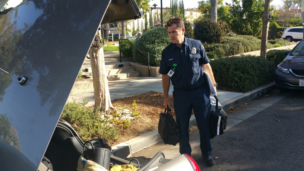 Glendale Fire Dept. Paramedic Gilberto Mejia prepares for a house call at a Glendale home.
