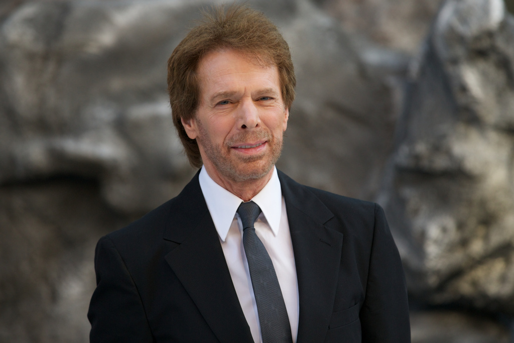 US film and television producer Jerry Bruckheimer poses for pictures at the UK premier of the film 'The Lone Ranger' in Leicester Square, central London on July 21, 2013.