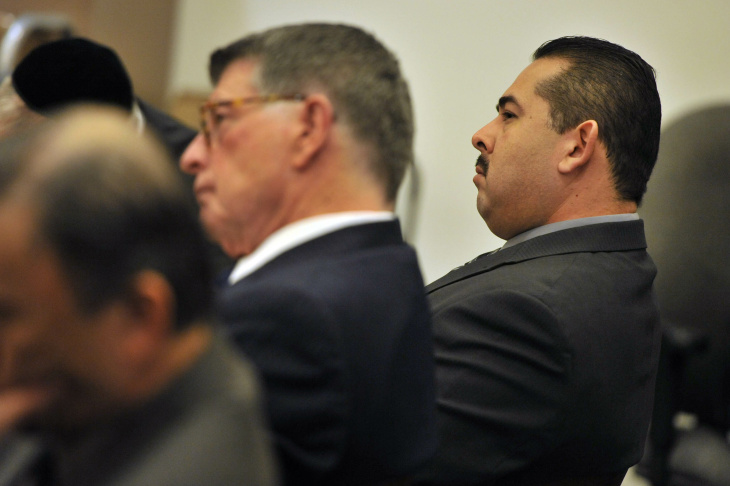 Former Fullerton police officer Manuel Ramos (right) in court Tuesday with his attorney John Barnett.