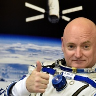 US astronaut Scott Kelly gestures as his space suit is tested at the Russian-leased Baikonur cosmodrome, prior to blasting off to the International Space Station (ISS), late on March 27, 2015.